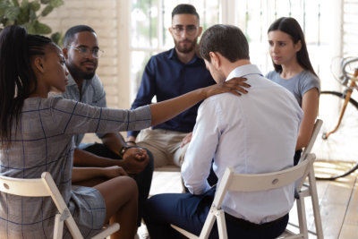 Mixed race diverse team of workers sitting in circle on group therapy.